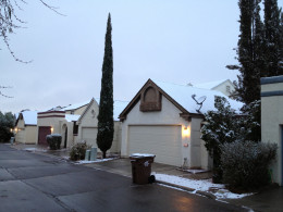 Snow covered roof tops and satellite dishes in my north Tucson neighborhood.