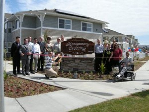 USDA Rural Development staff Bret Helgren and Fred Smith joined others to help cut the ribbon at the grand opening of Montgomery Crossing Apartments in Lemoore.