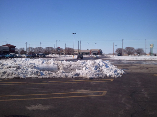 "clear blue skies and piles of snow from round 1 of the snow storm that blanketed wichita, ks with 14+"" of snow 2/24/2013"