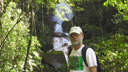A water falls located on the southeast flank of Volcano Miravalles and yours truly.  There are old growth trees along the steep walk up to the falls.  We arrived at the base of the trail on a tractor-pulled cart.