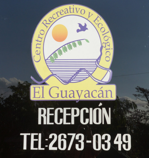 The El Guayacán sign at the reception desk.  Rooms and cabins are available.