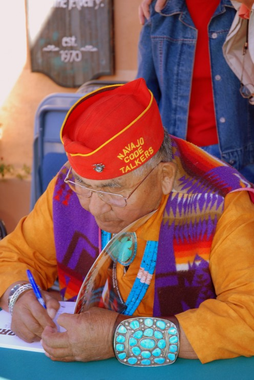 This man served in World War II as a Navajo Code Talker. Navajos created the only code talk system in modern history never to be broken.  Code talkers helped end WW II. Read more at: http://www.navajocodetalkers.org.