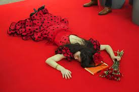 Camila on a blood red carpet.