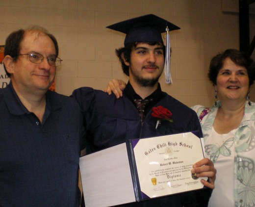 Rob, the graduate, with his parents:  my brother, Larry & my sister-in-law Kathy