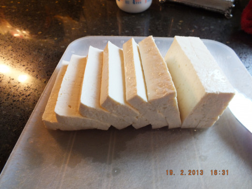 "Slice your tofu about half an inch thick. I like firm or extra firm. You can even freeze it the night before and thaw in the morning. That helps give it more of a ""meaty"" texture."
