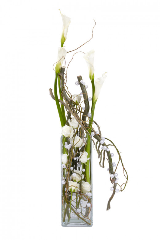 A really lovely centerpiece, yet still simple. Bare branches, mixed with white calla lilies and white mega beaded wire, all in a square cylinder vase.