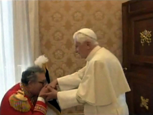Fra' Matthew Festing, the 79th Prince and Grand Master of the Sovereign Military Order of Malta, kissing Pope Benedict XVI's ring. They are working for the Pope.