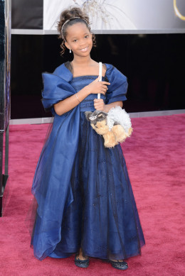 Quvenzhane Wallis looks like a princess and I love her purse.