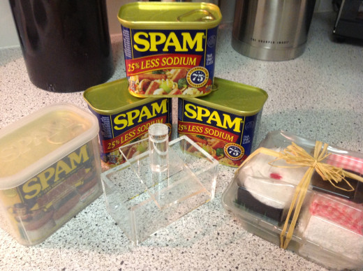 Notice the acrylic spam musubi press.  I've seen families utilize  the spam cans themselves as a press after removing the bottoms.