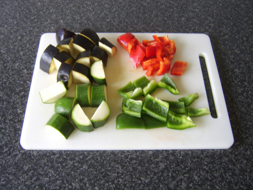 Larger vegetables are roughly chopped for roasting