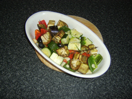 Roasted vegetables are removed from the oven