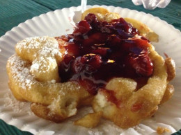 Don't forget the famous funnel cake.  This one topped with cherries and sprinkled with powdered sugar is to die for!