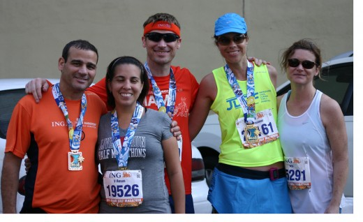 This team is celebratng a great run in the Miami Marathon.