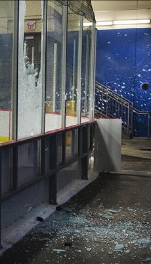 Plexiglass shatters as a result of impact from a hockey puck. Think a 3400 stock car could do more damage?