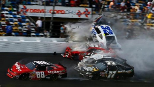 Kyle Larson's car sails into the Daytona frontstretch catch fence on the final lap of the Daytona Nationwide race