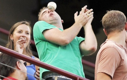 An unidentified fan takes a baseball to the face