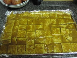 Carefully pour the liquid caramel over crackers, but don't be too slow about it. As soon as it leaves the hot pan it will start to thicken and get harder to spread.