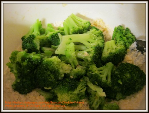 Fresh steamed broccoli from the microwave on top of fritter mixture. Waiting for a good mash-up.
