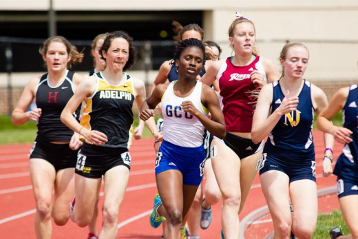 A group of runners halfway through a 1500m run during an invitational meet at TCNJ.