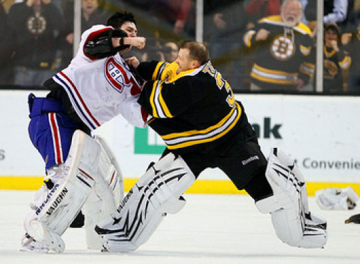 Tim Thomas and Cary Price fight in a Boston-Montreal NHL game.