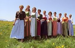 Pretty Maids all in a row - Look at the bright colors or summer dirndls in this line up