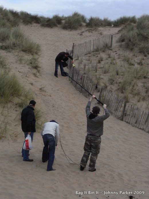 Dog poo bags in the sand dunes