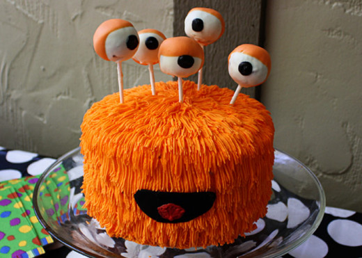 A super cool monster cake with cake pops as eyes