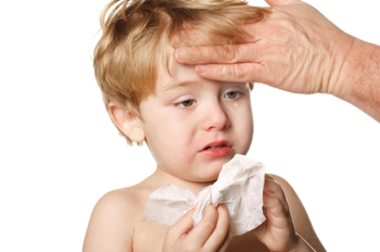 use your hand to feel the brow of a sick child to see if he has a fever