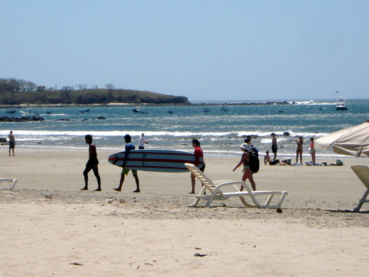 A paddle board being toted across Playa Tamarindo.  Tamarindo is popular with surfers and it has an estuary where there are tours.