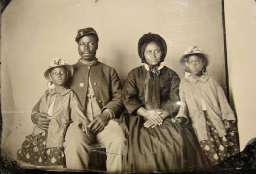 Only known photograph of a black Union soldier with his family. ca.1863-65