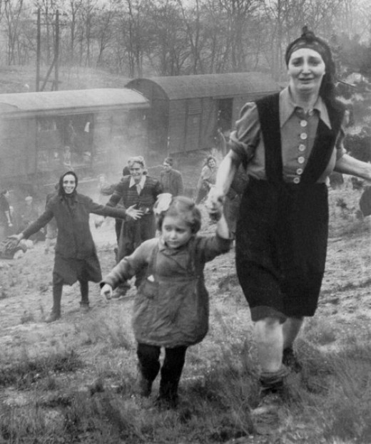 Jewish refugees, approaching allied soldiers, become aware that they have just been liberated, April, 1945.