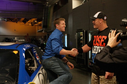 Carl Edwards and former WWE Champion John Cena; numerous pro wrestling organizations have been involved with NASCAR on some level