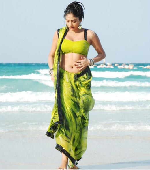 Haripriya on the beach, traditional sari outfit.