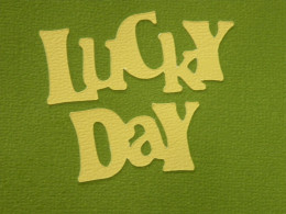 Lucky Day phrase adhered to a background