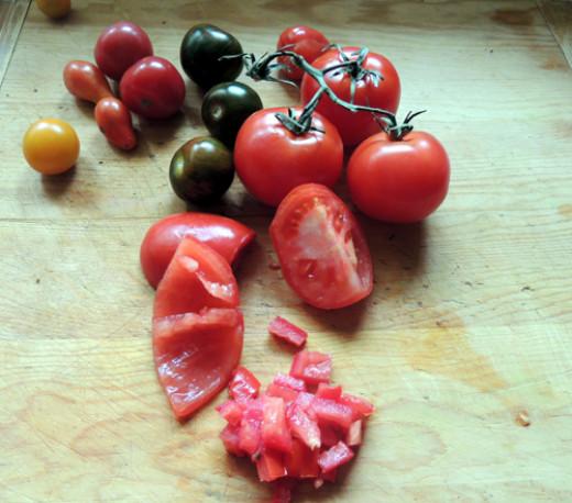 gather tomatoes, slice into halves