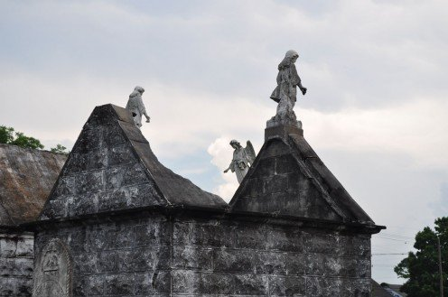 Collapsed tomb roofs with angels above