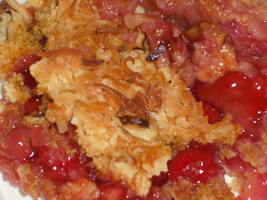 Simply delicious dump cake, featuring pineapple and cherries.