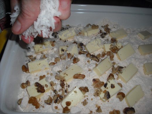 Sprinkle nuts and flaked coconuts over the top, if desired.  I have made this dump cake half with and half without, as some of my household members are not fond of nuts or coconut.