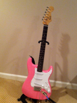 Squier electric guitars are designed for young guitarists.  This one is modeled on the Fender Stratocaster.