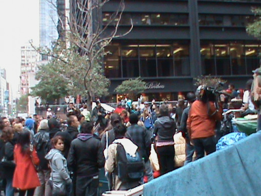 Crowd gathering to watch spontaneous, and completely pointless, episodes of semi-naked dancing during an Occupy protest.