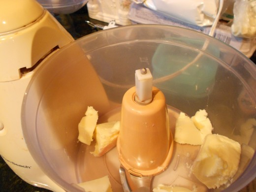 Place cut butter into food mixer and cream before adding sugar