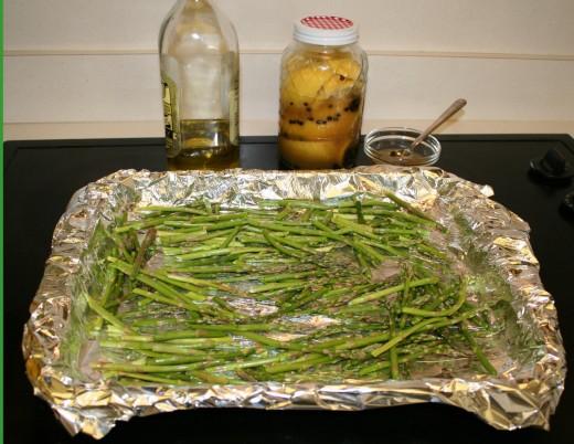 Olive oil, Moroccan Preserved Lemon tossed on the baking sheet.