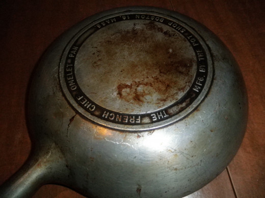 "Here is what the bottom of the pan looks like. It actually says ""The French Chef Omelet"" and ""MFG. By The Pot Shop Boston 16' MASS."""