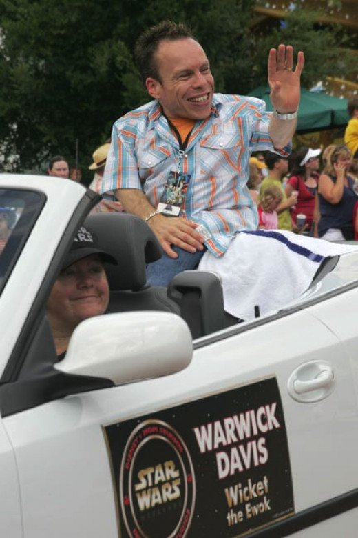 Warwick Davis In The Parade: Don't miss the daily parade but be sure to arrive early for the best views.