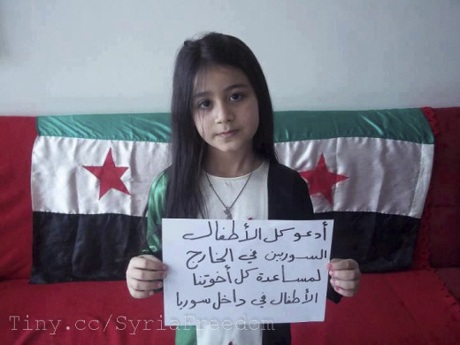 A little girl calling on all Syrian children outside Syria to help and support those children trapped inside under Assad regime.