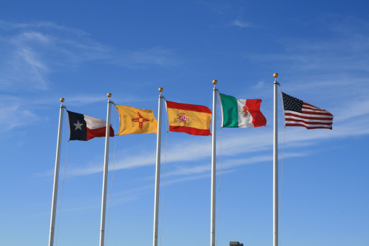Flags over a border straddling park....