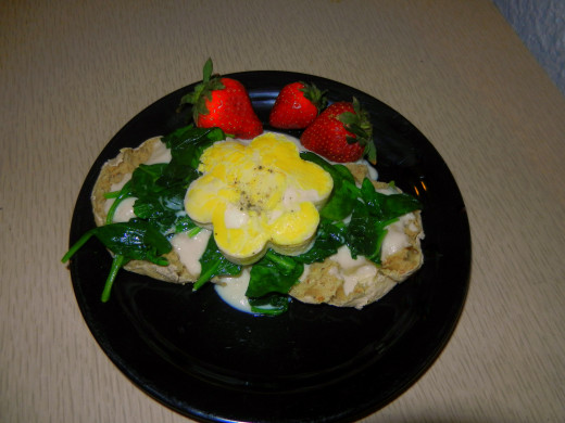 Eggs Florentine with the cheese sauce under the spinach.