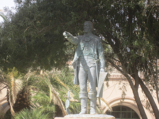 Statute of Tucson Founder Hugo O'Connor gazes toward the St. Patrick's Day Parade Route