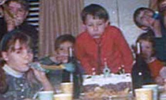 Barbara, right, Kevin strangling himself, left, me blowing out candles
