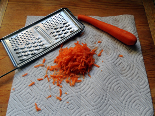 shred carrots. add all 4 items to a mixing bowl